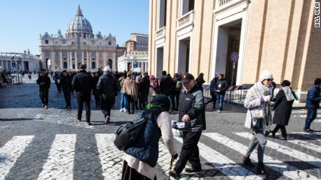 A woman begs for change in St. Peter's Square. The Pope chose the name Francis as a tribute to Saint Francis of Assisi, an Italian man who dedicated his life to the poor.