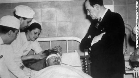 Doctors attend exiled Russian revolutionary leader Leon Trotsky as he nears death in 1940.