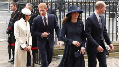 The Duchess of Cambridge (2R) and Prince William (R) arrive with Prince Harry (C) and Meghan Markle on Monday.