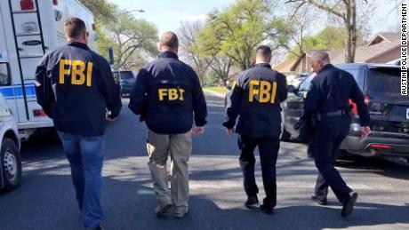 An image tweeted by the Austin police department shows members of the FBI.