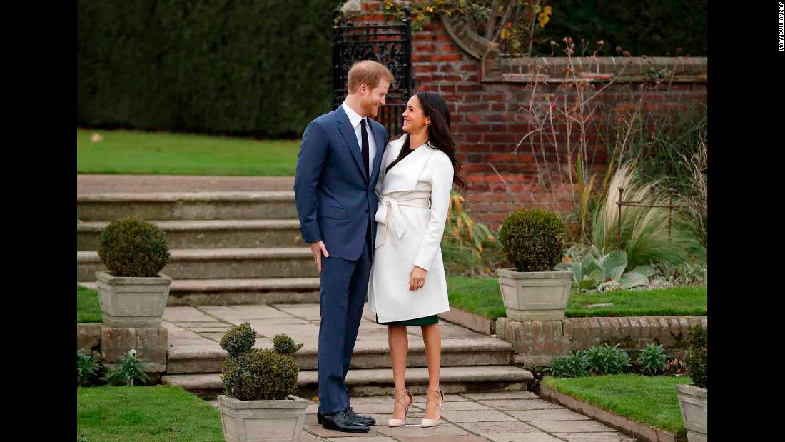"The couple poses for photos at Kensington Palace in November 2017, after <a href=""https://edition.cnn.com/2017/11/27/europe/prince-harry-meghan-markle/index.html"" target=""_blank"">their engagement was announced.</a>"