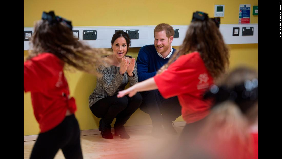 The couple watches a dance class during a visit to Cardiff, Wales, in January 2018.