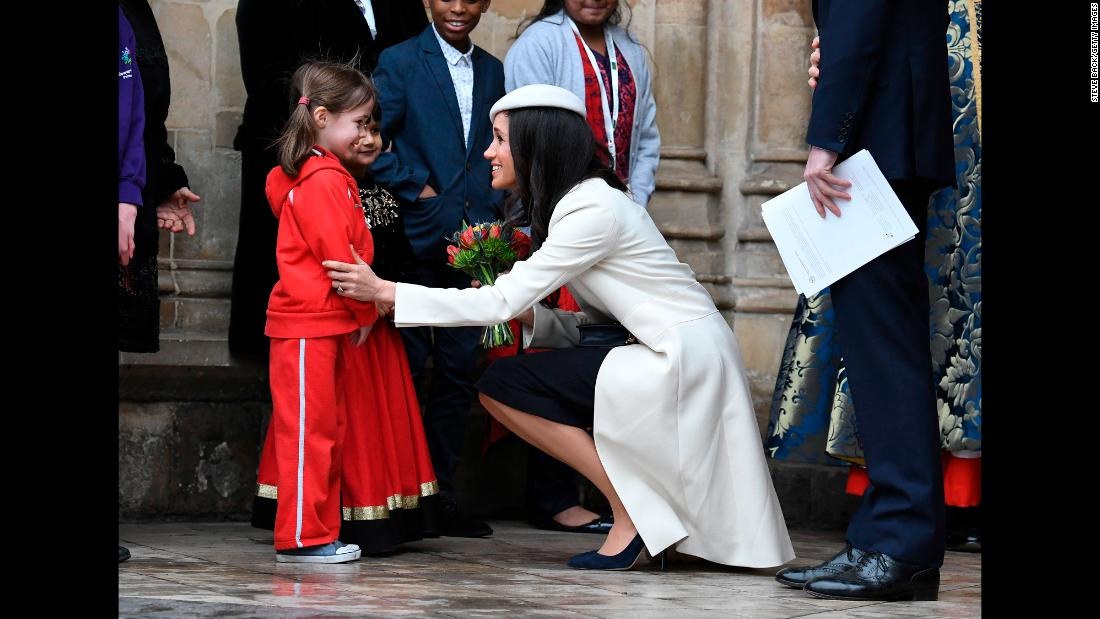 "Markle talks to a girl during a Commonwealth Day service in London in March. It was <a href=""https://www.cnn.com/2018/03/12/europe/meghan-markle-queen-elizabeth-commonwealth-intl/index.html"" target=""_blank"">the first time</a> Markle joined Queen Elizabeth II at an official public engagement."