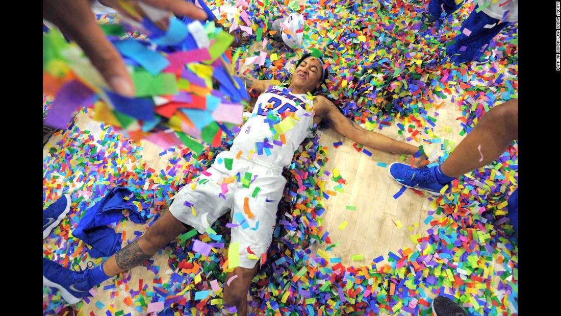"DePaul forward Mart'e Grays makes a ""confetti angel"" after her team won the Big East basketball tournament on Tuesday, March 6."