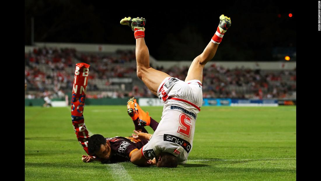 Jason Nightingale, right, scores a try for the St. George Illawarra Dragons during a National Rugby League match in Sydney on Thursday, March 8. The Dragons defeated the Brisbane Broncos 34-12 in their first match of the season.