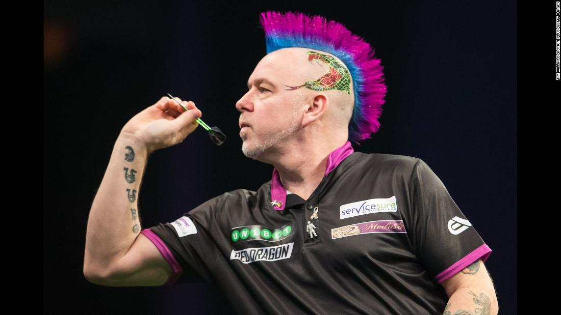 The always colorful Peter Wright competes in a Premier League Darts match in Leeds, England, on Thursday, March 8.