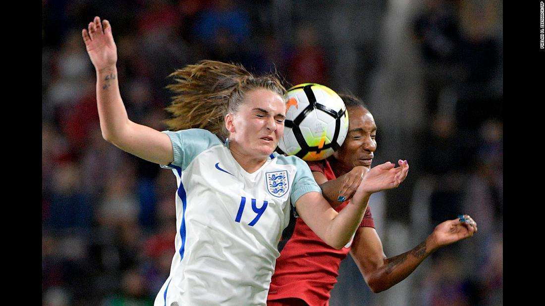 England forward Mel Lawley, left, and US forward Crystal Dunn compete for a header during a soccer match in Orlando, Florida, on Wednesday, March 7. The Americans won the match 1-0 to clinch the SheBelieves Cup.