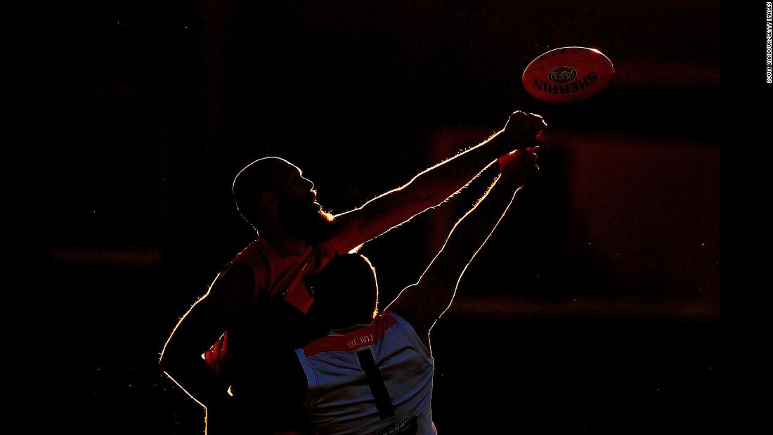 Melbourne's Max Gawn, top, and St. Kilda's Tom Hickey compete for the ball during an Australian Football League match on Thursday, March 8.