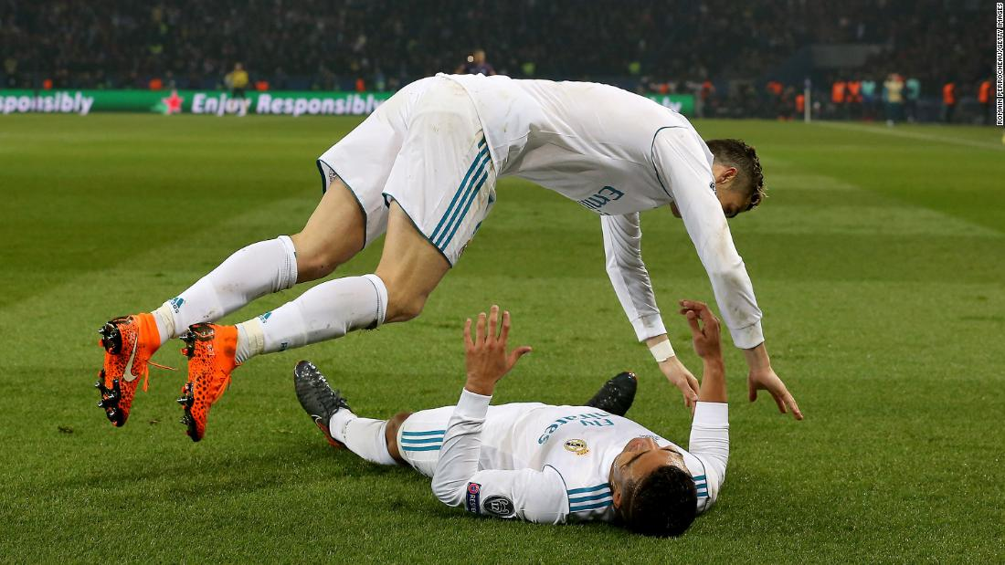 Cristiano Ronaldo jumps onto Real Madrid teammate Casemiro as they celebrate a Champions League goal in Paris on Tuesday, March 6. Madrid defeated Paris Saint-Germain 5-2 on aggregate to advance to the quarterfinals.