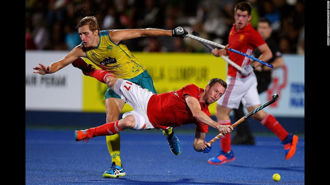 England's Barry Middleton is tackled by Australia's Daniel Beale during the final of a field hockey tournament in Ipoh, Malaysia, on Saturday, March 10. Australia won 2-1 to claim the Sultan Azlan Shah Cup.