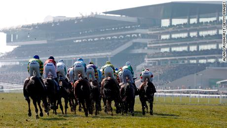 CHELTENHAM, ENGLAND - MARCH 17:   A general view as runners turn into the straight in The Pertemps Network Final clear a hurdle in the country during Cheltenham Festival - St Patrick's Thursday at Cheltenham racecourse on March 17, 2016 in Cheltenham, England.  (Photo by Alan Crowhurst/Getty Images)