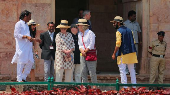 Former US politician Hillary Clinton (C) tours the Jahaj Mahal part of an abandoned royal palace complex, while on a personal trip to the ancient city of Mandu in India's Madhya Pradesh state on March 12, 2018.