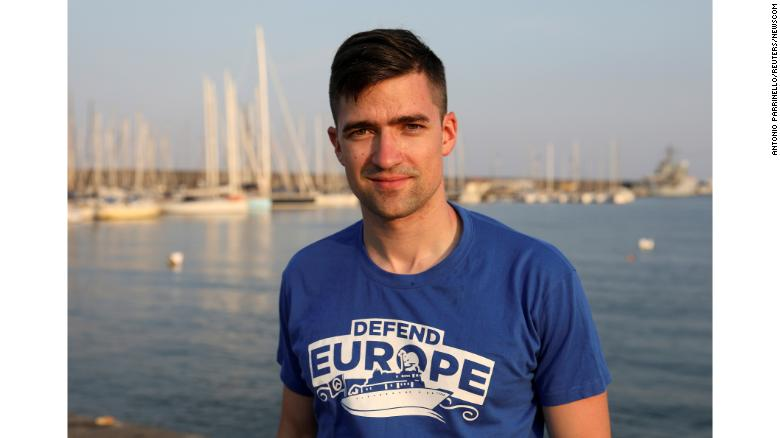 Martin Sellner, the leader of Generation Identity, poses in the harbor of Catania, Italy, in July.