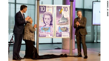 Canadian Finance Minister Bill Morneau, Desmond's sister Wanda Robson and Bank of Canada governor Stephen Poloz, right, helped unveil the design for the new bank note.