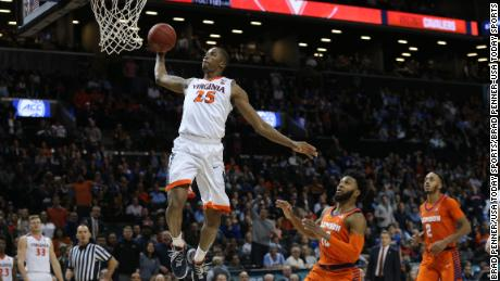 Virginia Cavaliers forward Mamadi Diakite (25) dunks against Clemson Tigers guard Gabe DeVoe (10) and guard Marcquise Reed (2) during the second half of a semifinal game of the 2018 ACC tournament at Barclays Center.