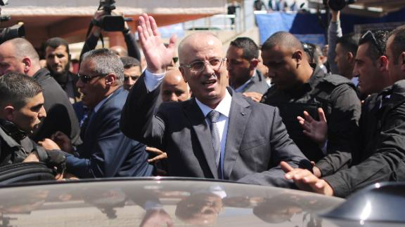 Hamdallah waves to crowds upon his arrival in Gaza City on Tuesday.