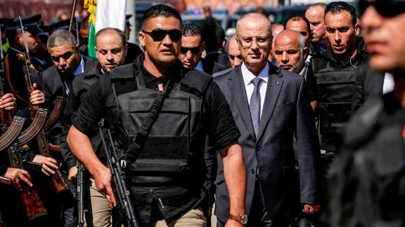 Palestinian Prime Minister Rami Hamdallah (3rd-R), escorted by his bodyguards, is greeted by police forces of the Islamist Hamas movement (L) upon his arrival in Gaza City on March 13, 2018. / AFP PHOTO / MAHMUD HAMS        (Photo credit should read MAHMUD HAMS/AFP/Getty Images)