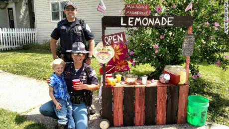 Malachi's lemonade stand offers free drinks for police officers, firemen and first responders.