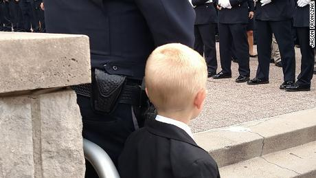 Malachi attends Lt. Aaron Allan's funeral on August 5, 2017.