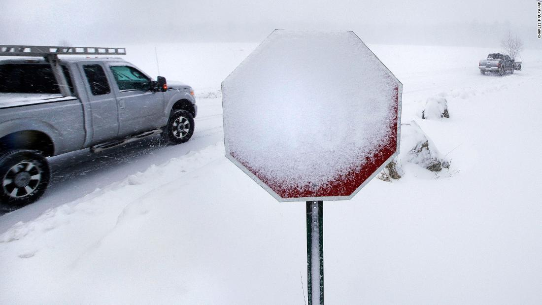 Wind-blown snow covers a stop sign in Derry, New Hampshire, on March 13.