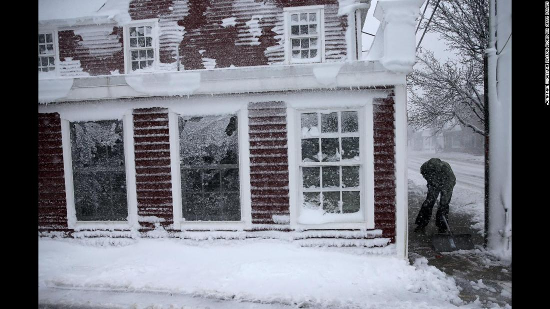 Cole Stiles clears a sidewalk in Scituate, Massachusetts, on March 13.