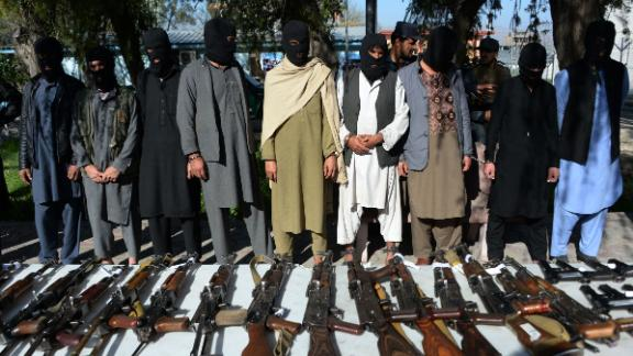Alleged Taliban fighters and other militants stand handcuffed while being presented to the media at a police headquarters in Jalalabad on March 6, 2018.  Afghan police said over 17 alleged Taliban militants including two Pakistani nationals were arrested during a five-week operation in Nangarhar province. / AFP PHOTO / NOORULLAH SHIRZADA        (Photo credit should read NOORULLAH SHIRZADA/AFP/Getty Images)