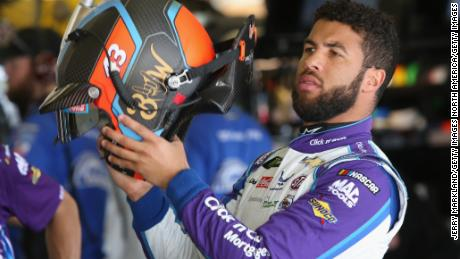 HAMPTON, GA - FEBRUARY 24: Darrell Wallace Jr., driver of the #43 NASCAR Racing Experience Chevrolet, stands in the garage area during practice for the Monster Energy NASCAR Cup Series Folds of Honor QuikTrip 500 at Atlanta Motor Speedway on February 24, 2018 in Hampton, Georgia.  (Photo by Jerry Markland/Getty Images)