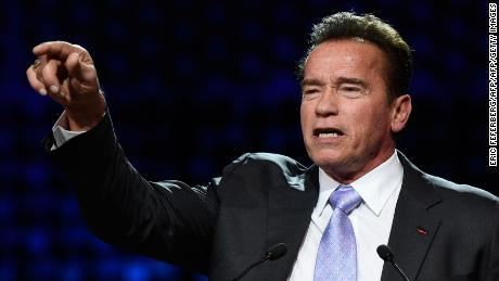 "Former Governor of California and US actor Arnold Schwarzenegger speaks during a panel conference at the One Planet Summit on December 12, 2017, at La Seine Musicale venue on l'ile Seguin in Boulogne-Billancourt, west of Paris. ?The French President hosts 50 world leaders for the ""One Planet Summit"", hoping to jump-start the transition to a greener economy two years after the historic Paris agreement to limit climate change. / AFP PHOTO / Eric FEFERBERG        (Photo credit should read ERIC FEFERBERG/AFP/Getty Images)"