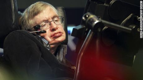 "JERUSALEM, ISRAEL - DECEMBER 14:  British scientist Prof. Stephen Hawking gives his ""The Origin of the Universe"" lecture to a packed hall December 14, 2006 at the Hebrew University of Jerusalem, Israel. Hawking suffers from ALS (Amyotrophic Lateral Sclerosis or Lou Gehrigs disease), which has rendered him quadriplegic, and is able to speak only via a computerized voice synthesizer which is operated by batting his eyelids. (Photo by David Silverman/Getty Images)"
