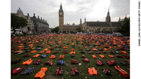 TOPSHOT - 2,500 lifejackets, worn by refugees during crossings from Turkey to the Greek island of Chios, are displayed on Parliament Square, opposite the Houses of Parliament, in central London, on September 19, 2016, during a photocall to highlight the number of refugees that have died trying to reach Europe since 2015. A summit to address the biggest refugee crisis since World War II opens at the United Nations on Monday, overshadowed by the ongoing war in Syria and faltering US-Russian efforts to halt the fighting. World leaders will adopt a political declaration at the first-ever summit on refugees and migrants that human rights groups have already dismissed as falling short of the needed international response. / AFP / Daniel Leal-Olivas        (Photo credit should read DANIEL LEAL-OLIVAS/AFP/Getty Images)