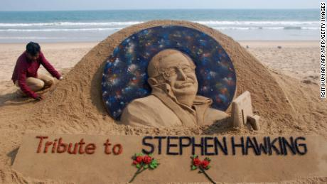 "Sand artist Sudarsan Patnaik gives final touches to a sculpture in honour of British physicist and award-winning author Stephen Hawking at Puri beach, some 65 kms. from Bhubaneswar on March 14, 2018.  Renowned British physicist Stephen Hawking, whose mental genius and physical disability made him a household name and inspiration across the globe, died on February 14th aged 76. Propelled to superstardom by his 1988 book ""A Brief History of Time"", which became an unlikely worldwide bestseller, Hawking dedicated his life to unlocking the secrets of the Universe.  / AFP PHOTO / ASIT KUMAR        (Photo credit should read ASIT KUMAR/AFP/Getty Images)"