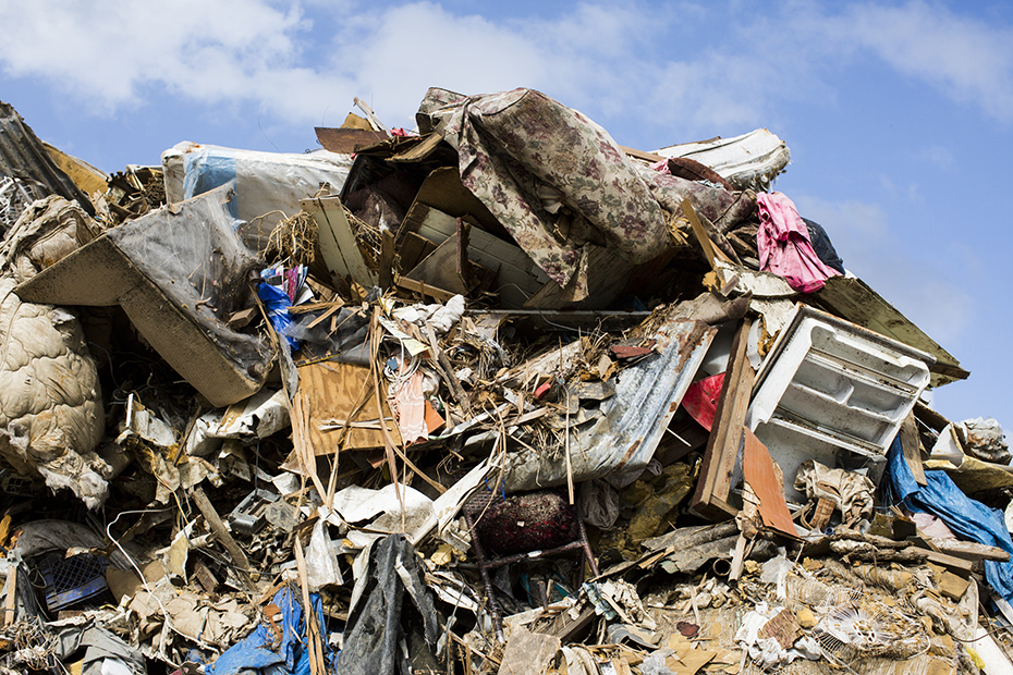 Hurricane debris is piled up at a temporary dump in March in Maunabo.