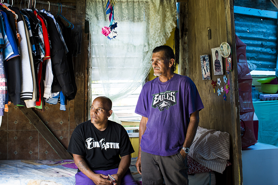 Héctor Pedraza, left, lost his mother -- Herminio Trinidad's wife -- when she died in February in the aftermath of Maria.