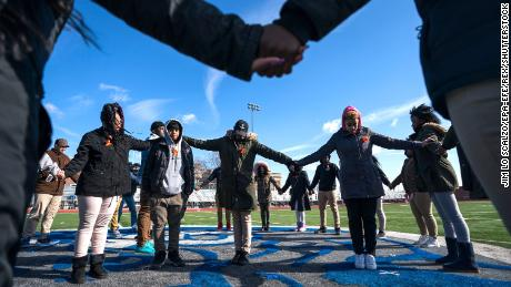 Mandatory Credit: Photo by JIM LO SCALZO/EPA-EFE/REX/Shutterstock (9458881a) Eastern High School students walk out of class and assemble on their football field for the National School Walkout, a nation-wide protest against gun violence, in Washington, DC, USA, 14 March 2018. Organizers of the 17-minute protest,  one minute for each victim of the Stoneman Douglas High School shooting that took place on 14 February, hope to call attention to Congressional inaction on the issue. National School Walkout in Washington, DC, USA - 14 Mar 2018