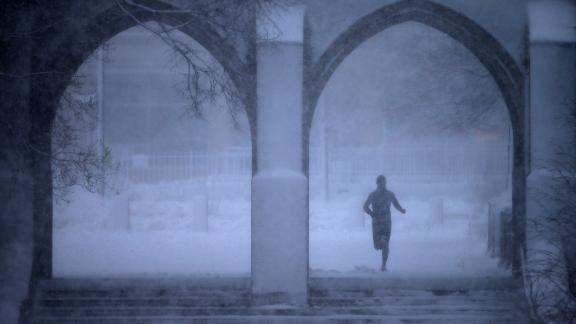 A jogger passes through the Boston University campus on Tuesday, March 13. A winter storm -- the third nor