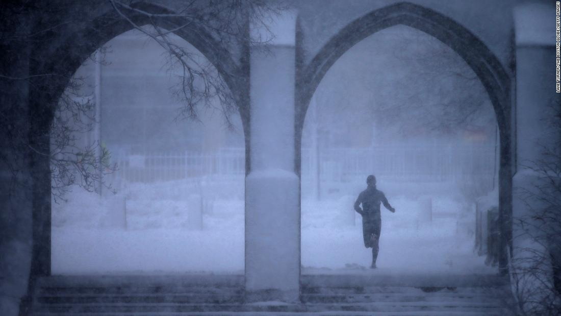 "A jogger passes through the Boston University campus on Tuesday, March 13. A winter storm -- <a href=""https://www.cnn.com/2018/03/13/weather/northeast-winter-storm/index.html"" target=""_blank"">the third nor'easter in two weeks</a> -- is threatening the region once again."