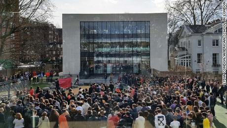 Students at the American School in London hold their walkout.
