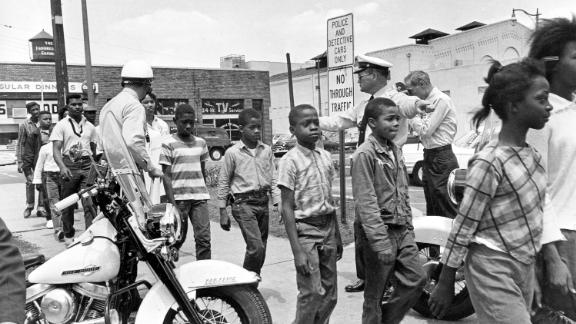 Policemen leading a group of black school children into jail, following their arrest for protesting against racial discrimination near the city hall of  Birmingham, Ala., on May 4, 1963. (AP Photo/Bill Hudson)