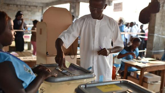 A man casts his ballot in the general elections on March 7, 2018 at a polling station in Freetown.