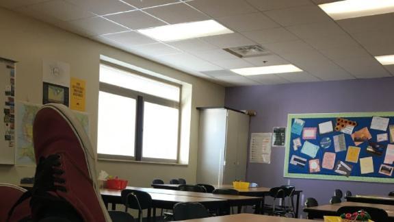 Noah Borba sits in an empty classroom Wednesday.
