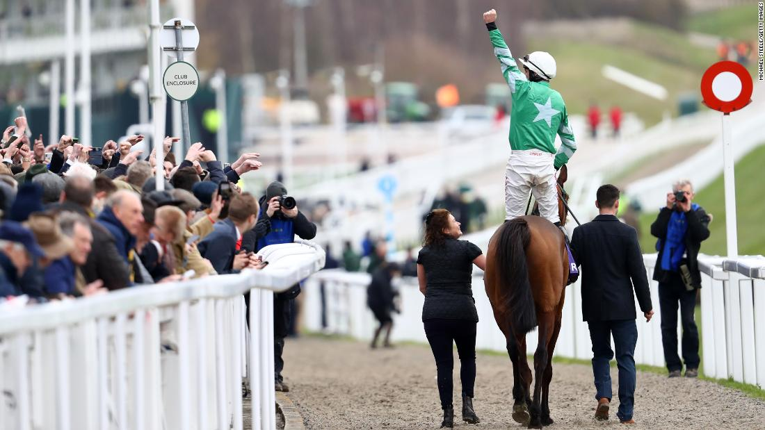 <strong>Cheers of the crowd: </strong>Jockey Davy Russell celebrates winning on impressive favorite Presenting Percy in the RSA Insurance Novices' Chase, a Grade 1 race and possible launch pad for a future Gold Cup campaign.