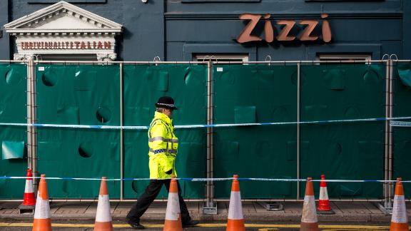 SALISBURY, ENGLAND - MARCH 11:  Police officers stand outside Zizzi restaurant as it remains closed as investigations continue into the poisoning of Sergei Skripal on March 11, 2018 in Salisbury, England. Sergei Skripal who was granted refuge in the UK following a 'spy swap' between the US and Russia in 2010 and his daughter remain critically ill after being attacked with a nerve agent.  (Photo by Chris J Ratcliffe/Getty Images)