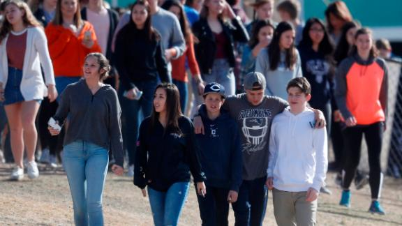 Columbine High School students walk out of class Wednesday in Littleton, Colorado.