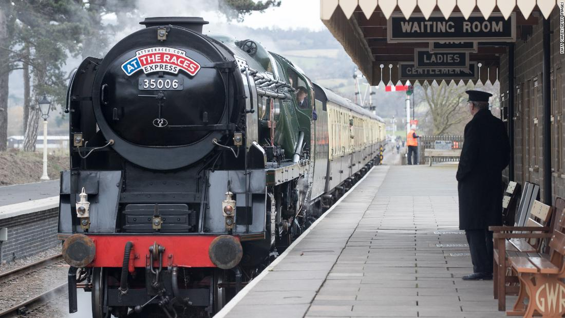 <strong>Steam age:</strong> Racegoers arrive in style on the historic Merchant Navy class Penisular and Oriental steam train at Cheltenham Racecourse station.