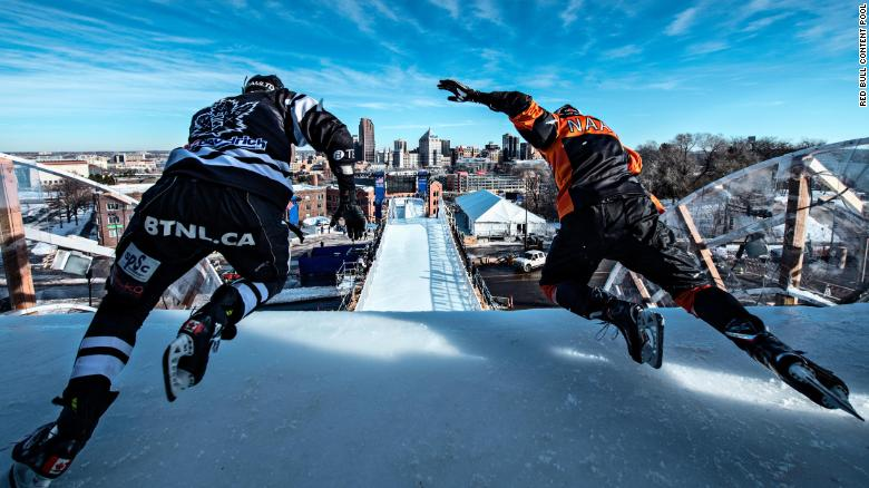 Cameron Naasz of the United States and Scott Croxall of Canada perform during a trainings session at the first stage of the ATSX Ice Cross Downhill World Championship at the Red Bull Crashed Ice in Saint Paul, United States on January 18, 2018. // Mihai Stetcu/Red Bull Content Pool // AP-1UGE3HJ1N2111 // Usage for editorial use only // Please go to www.redbullcontentpool.com for further information. //