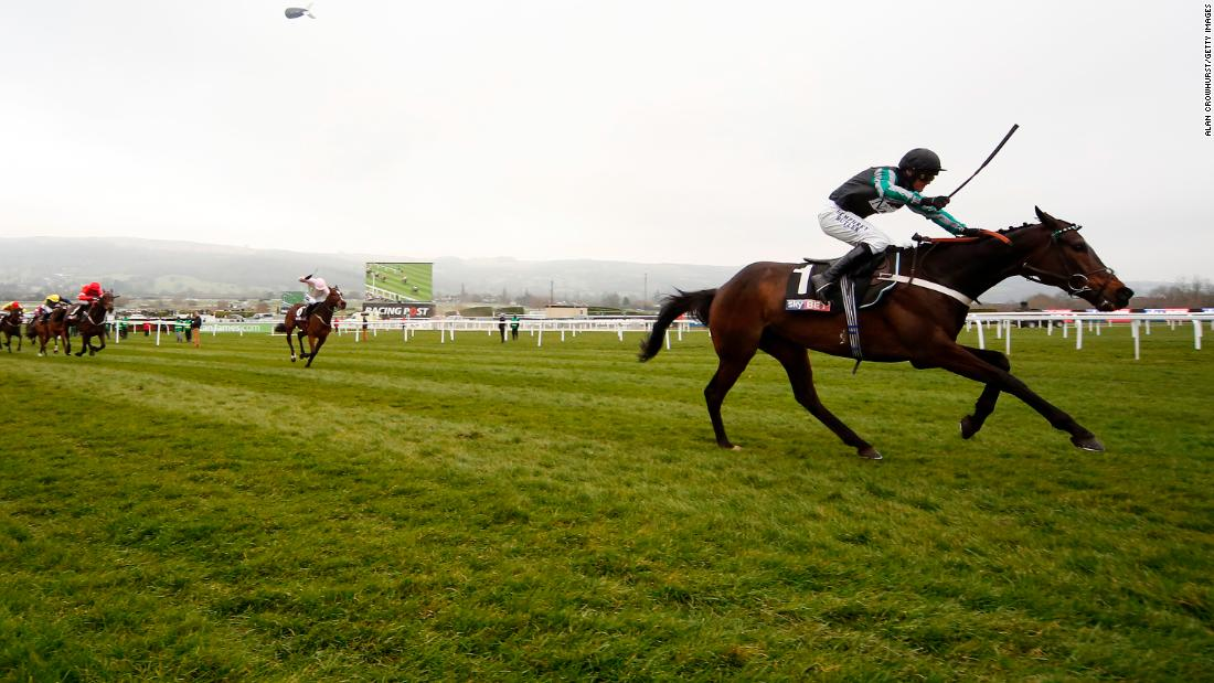 <strong>World's apart:</strong> Nico de Boinville and Altior struggled with the heavy ground but surged clear at the end to win by a distance.