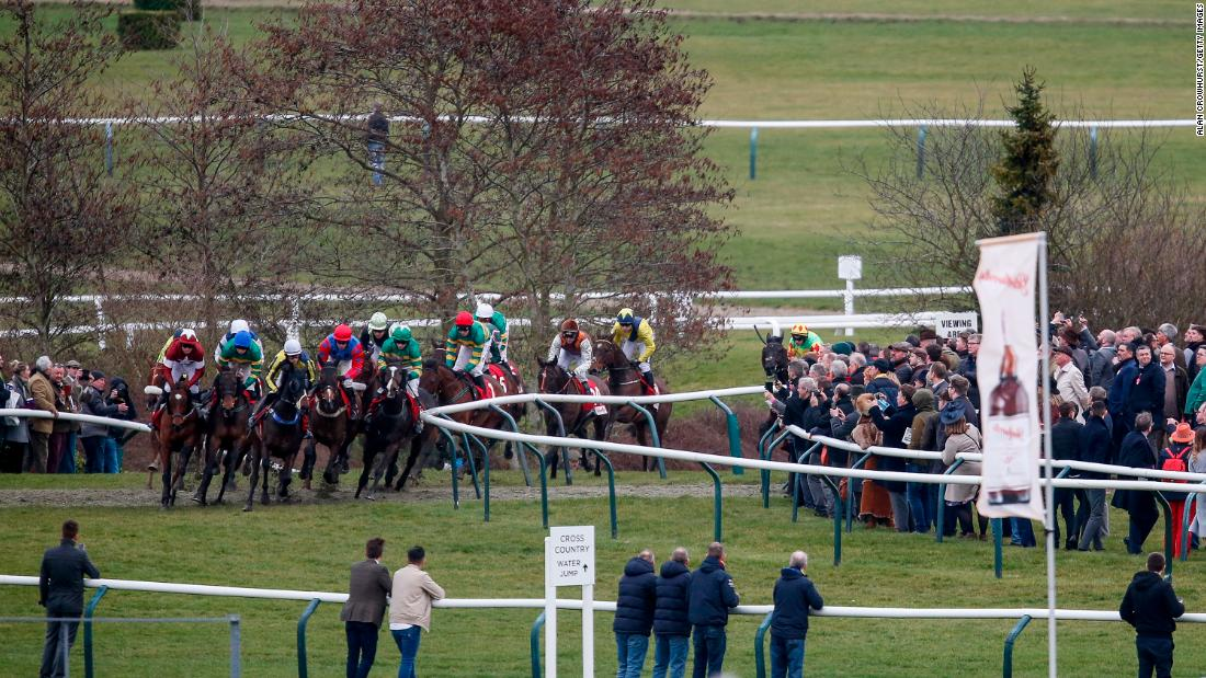 <strong>Tiger line:  </strong>Cheltenham stalwart<strong> </strong>Tiger Roll (left, maroon/white) won his third career race at the Festival with victory in the Glenfarclas Steeple Chase.
