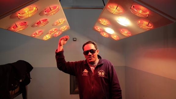 Horse drier: Zayed al Hashmi demonstrates heat lamps used to dry off horses after a swim.