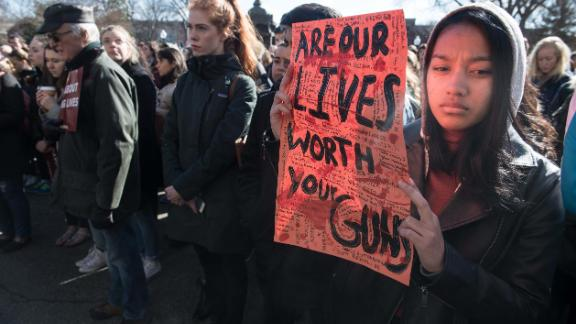 TOPSHOT - A student holds a sign at Georgetown University in Washington, DC, on March 14, 2018 during a national walkout to protest gun violence, one month after the school shooting in Parkland, Florida, in which 17 people were killed. / AFP PHOTO / NICHOLAS KAMM        (Photo credit should read NICHOLAS KAMM/AFP/Getty Images) *** BESTPIX ***