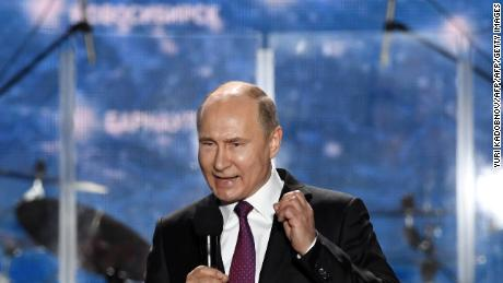 Vladimir Putin addresses supporters celebrating the fourth anniversary of Russia's annexation of Crimea.